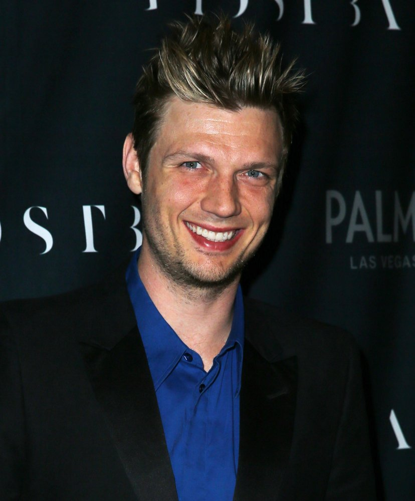 The youngest Backstreet Boy, Nick Carter, sprays himself with Gravity by Coty.